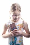 Kleines Mädchen mit Schokolade Lizenzfreies Stockfoto