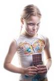 Kleines Mädchen mit Schokolade Stockfotografie