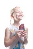 Kleines Mädchen mit Schokolade Lizenzfreie Stockfotografie