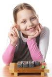 Kleines Mädchen mit Sushi Stockbilder