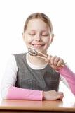 Kleines Mädchen mit Sushi Stockfotografie