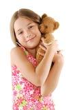 Kleines Mädchen mit Teddybären betreffen Weiß Stockbilder