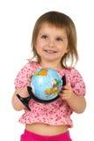 Kleines Mädchen mit terrestrischer Kugel lizenzfreie stockbilder