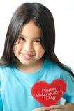 Kleines Mädchen mit Valentinsgrußkarte Stockbild