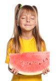 Kleines Mädchen mit Wassermelone lizenzfreie stockfotos