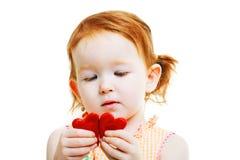 Kleines Mädchen mit wenig rotem Herzen zwei Stockbilder