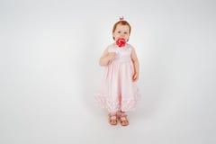 Kleines Mädchen mit Zuckerstange Lizenzfreies Stockfoto