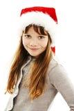 Kleines Mädchen in rotem Sankt-Hut. Porträt lizenzfreie stockfotografie