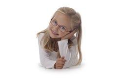 Kleines Mädchen-tragende Gläser Stockfotos