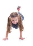 Kleines Mädchen tut Gymnastik Stockfotos