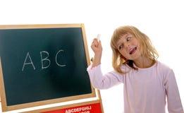 Kleines Mädchen und ABC Stockfoto