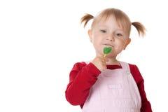 Kleines Mädchen und Lutscher Stockfotografie