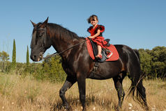 Kleines Mädchen und Pferd lizenzfreie stockbilder