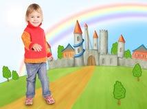Kleines Mädchen und Schloss Stockfotografie