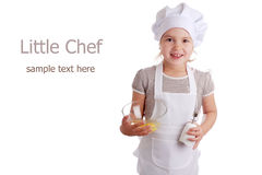 Kleines Mädchen gekleidet als Koch Stockfotografie
