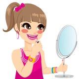 Kleines Mädchen-Make-up Stockfoto
