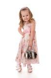 Kleines Mädchen mit einem Beutel in seiner Hand Lizenzfreies Stockbild