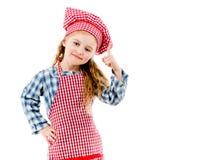 Kleines nettes Chefmädchen, das oben lokalisiert auf weißem Hintergrund zeigt Stockfotografie
