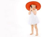 Kleines nettes Mädchenkind in einem roten Hut Lizenzfreie Stockfotografie
