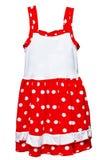 Kleines rotes Polkapunktkleid für Mädchen auf Weiß Lizenzfreies Stockbild
