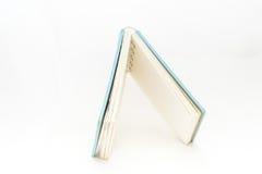 Kleines Taschennotizbuch auf Hintergrund Lizenzfreie Stockfotos