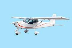 Kleines weißes Flugzeug des Einzeltriebwerks getrennt Stockfotos