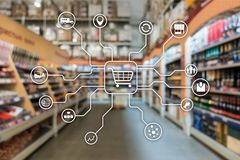 Kleinhandels marketing kanalene-commerce het Winkelen automatiseringsconcept op vage supermarktachtergrond stock foto