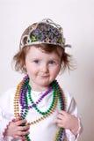 Kleinkind, das Karneval feiert stockfotografie