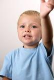 Kleinkind, das mit seinen Augen bittet Stockbild