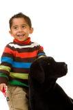 Kleinkind mit angefülltem Hund Stockbilder