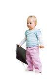 Kleinkind mit einem Klemmbrett stockfotografie