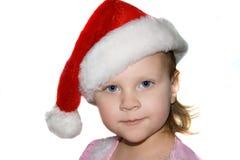 Kleinkindkind, das einer Sankt den Hut trägt. Stockfoto
