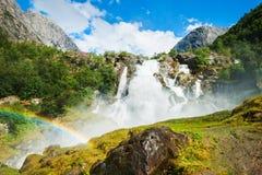 Kleivafossen waterfall near Briksdal glacier in Norway. Summer landscape stock photo