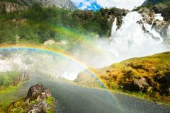 Kleivafossen waterfall with rainbow near Briksdal glacier in Norway royalty free stock photos