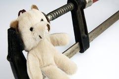 Klem op het hoofdteddybeerstuk speelgoed Stock Afbeeldingen