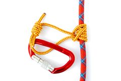 Klemheist or French Machard knot with a red locked carabiner attached. Can be tied with webbing or cord and is uni-directional. Meaning it can only be loaded stock images
