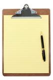 Klemmbrett und gelbes Papier Lizenzfreie Stockbilder