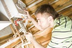Klempner bei der Arbeit Stockbilder