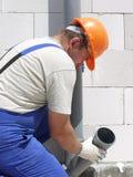 Klempner bei der Arbeit Lizenzfreies Stockfoto