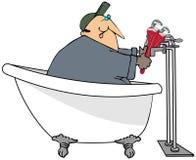 Klempner in einer Badewanne Stockfotografie