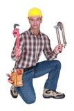 Klempner mit Werkzeugen Stockfotos