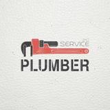Klempnerarbeitservice Portrait eines jungen Geschäftsmannes Reparatur und Wartung von Gebäuden Einfarbige typografische Aufkleber Stockfotos