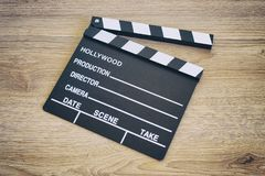 Kleppenraad, Filmklep op houten backgrond Royalty-vrije Stock Foto