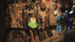 Kleren voor de jacht en visserij in de opslag stock videobeelden