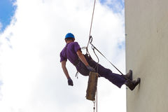 Klettern auf den Wandwolkenkratzern stockfotos