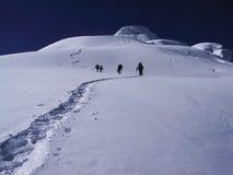 Klettern eines Berges Stockfotos