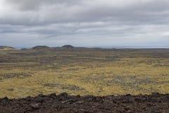 Klettern eines Kraters in Island Stockfotografie