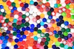 Kleuren plastic kappen stock afbeelding