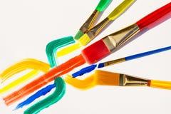 Kleurenpenselen en kleurentekening Stock Foto's