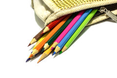 Kleurenpotloden in een zak Stock Afbeeldingen